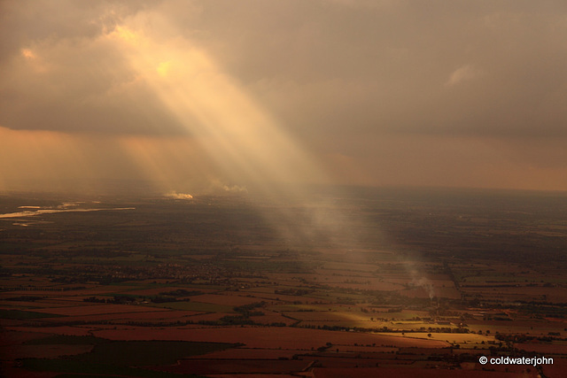 Aerial - Sunbeam breaking through the cloud cover on approach to Southend