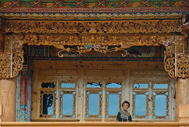 A boy look down the balcony