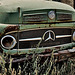 The one-eyed green Benz 1113......