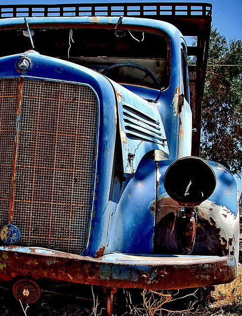 The dark eye of the blue Benz........