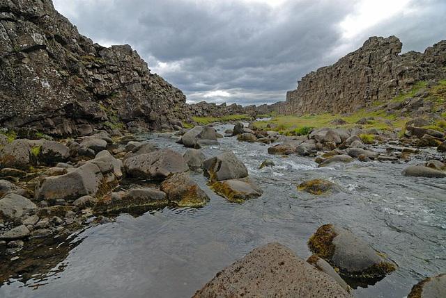 Fresh water runs down from the waterfall