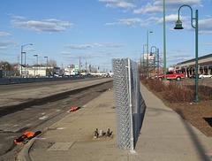 Chainlink fenceroll for splitting the sidewalk.