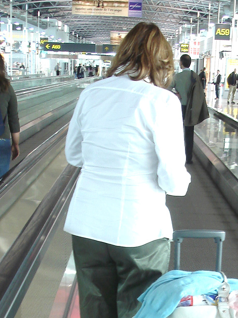 White blouse Lady in stiletto heels - Brussels airport /  19-10-2008