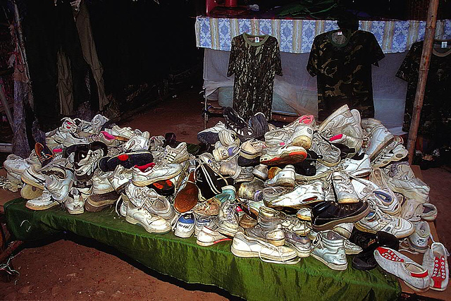 Offer of used sport shoes at the market in Chong Mek