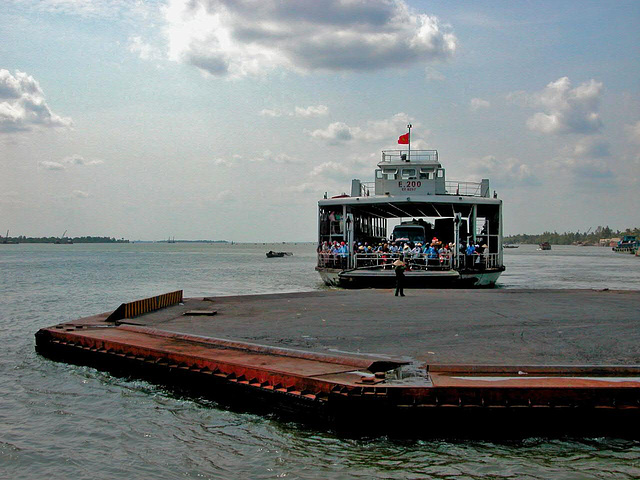 Boarding the ferry to across the Mekong branch