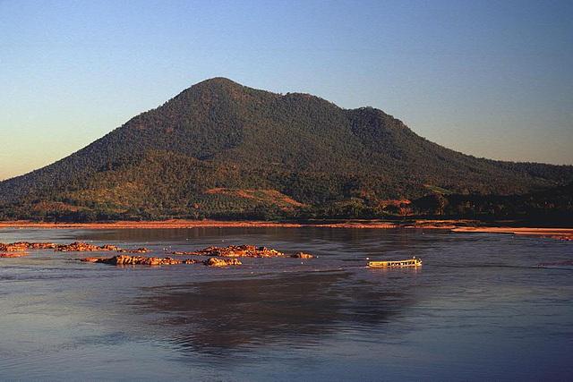 A public boat cruising on the Mekong near Chiang Khan