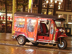 Amsterdam- Taxi enchanting sight.  Rouge roulant !!