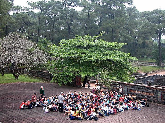 Pupils waiting for the entrance into the Tự Đức Mausoleum complex