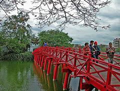 Crossing the Huc Bridge over the Hoàn Kiếm Lake