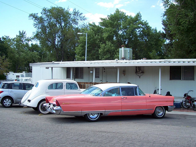 Mobile home with upwardly mobile cars