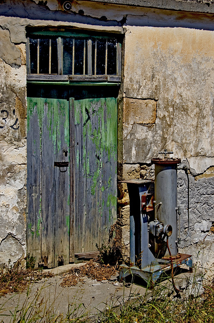 The green door and a machine