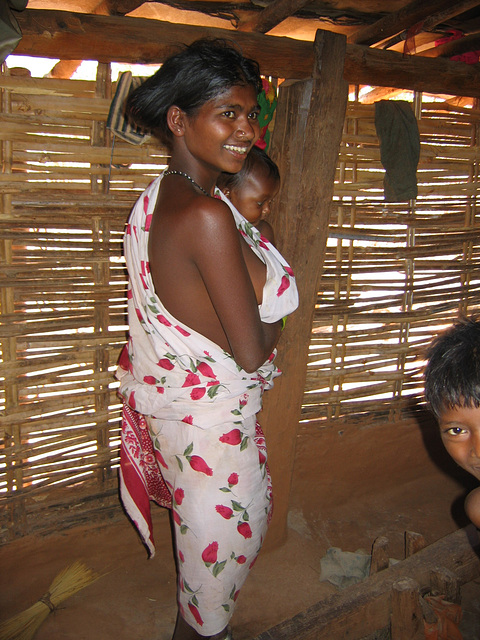 Young tribal mother with her baby