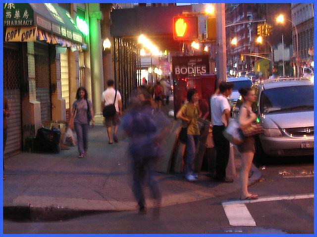 Blurry bodies on Walker street- NYC.