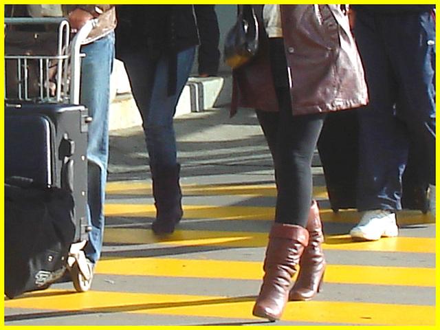 High heeled Boots and tights on yellow lines -  Bottes à talons hauts et collants sur lignes jaunes- Aéroport de Montréal.