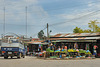 Phou Khoun and a market on the traffic refuge