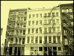 Windows & fire escapes- Fenêtres et escaliers de secours. Photofiltre - Photo à l'ancienne- Vintage effect.