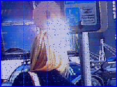 Divinité blonde en jeans et bottes à talons hauts avec boucles - Gorgeous blond Divinity in jeans and high heeled buckled boots- PET Montreal airport - Photofiltrée Mosaïque.