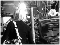 Divinité blonde en jeans et bottes à talons hauts avec boucles - Gorgeous blond Divinity in jeans and high heeled buckled boots- PET Montreal airport - Noir & blanc.
