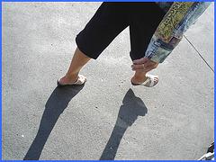 Blonde mature in white sexy strappy sandals-  Dame blonde du bel âge en sandales blanches à courroies -  Aéroport de Montréal.