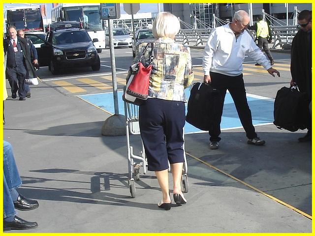Blond mature in white sexy strappy sandals-  Dame blonde du bel âge en sandales blanches à courroies -  Aéroport de Montréal.