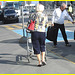 Blond mature in white sexy strappy sandals-  Dame blonde du bel âge en sandales blanches à courroies -  Aéroport de Montréal.