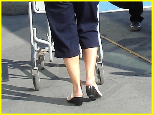 Blonde mature in white sexy strappy sandals - Dame blonde du bel âge en sandales blanches à courroies -  Aéroport de Montréal.