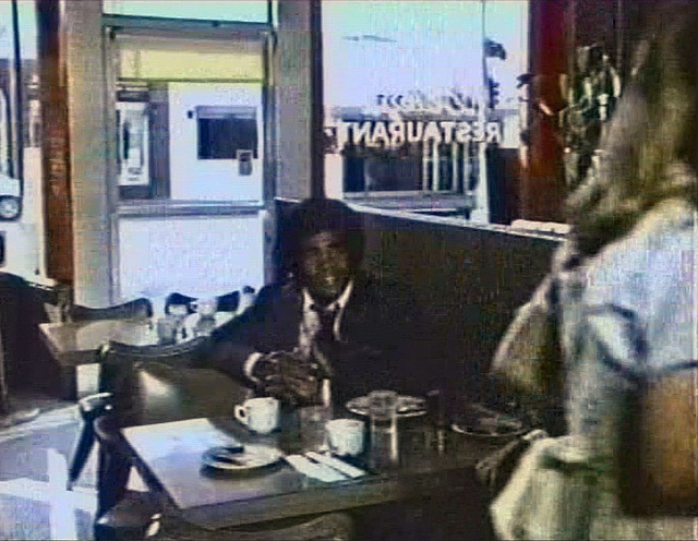 Timothy Brown in some cafe