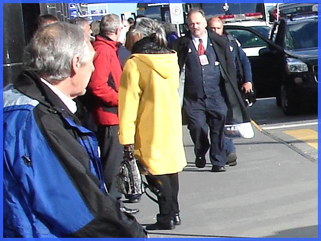 Grey haired attractive mature-  Charmante Dame du bel âge aux cheveux gris -PET Montreal airport- Aéroport de Montréal.