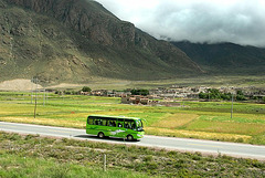 Modern tourist bus runs beside the Tibet train