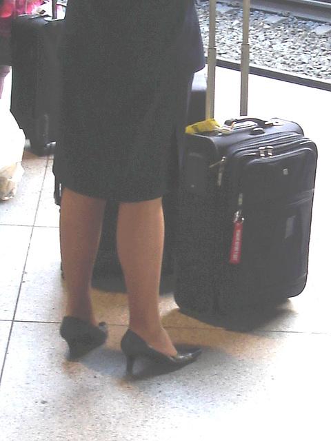 Blond flight attendant smoker in high heels shoes - Copenhagen train station airport  /  October 20th 2008