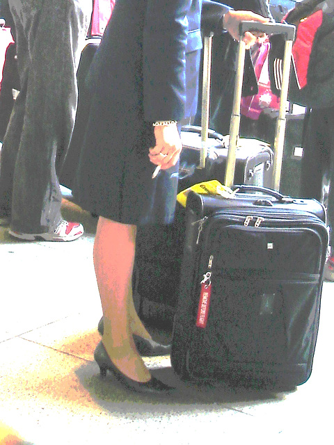 Blond flight attendant smoker in high heels shoes - Copenhagen train station airport  /  October 20th 2008