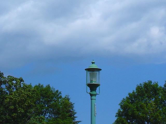 Lampadaire avec ciel et arbres  /   Street lamp with sky and trees.   Hometown  / Dans ma ville.  15 juillet 2009