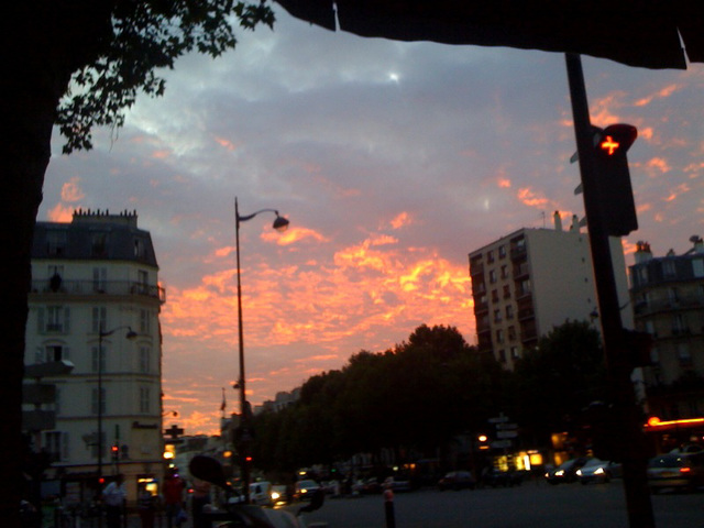 Sunset view from a café terrasse in Paris