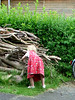 """Lina sawing firewood, Torben """"sawing"""" the green"""