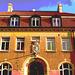 Imposant bâtiment traditionnel sur la rue principale avec une belle blonde en prime / Towering Swedish architectural building on main street and a discreet blond Lady .  Båstad  /  Suède  - Sweden.  23 octobre 2008  - Traitement de postérisation
