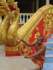 Monk repairing a Nara, mythological Dragon