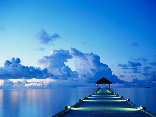 En dok ved solnedgang på White Sands Island på Maldiverne. - Angelo Cavalli