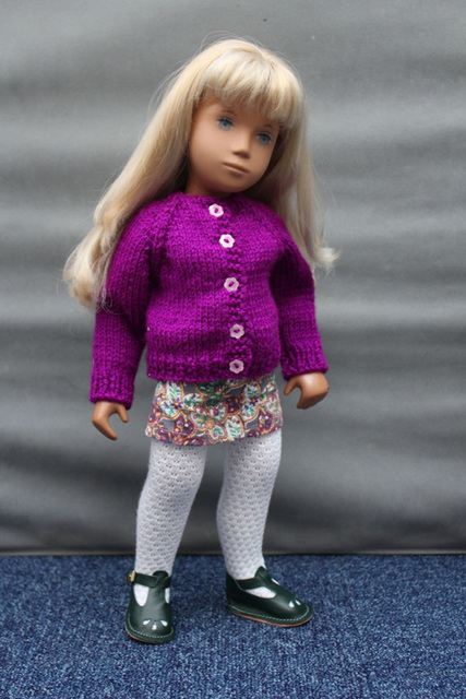 Stevie tries on her new cardigan and shoes