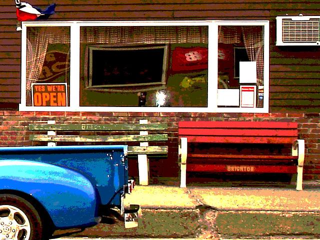 Bancs et derrière de camion bleu /  Benches and blue rear truck.   Brighton.  USA.   23 -05-2009  - Yes we're open. Postérisation