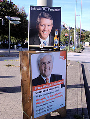 """Bierwerbung über Wahlwerbeplakat (""""I want 0,0 percent!""""- advertising for non-alcoholic beer quite above election advertising poster)"""