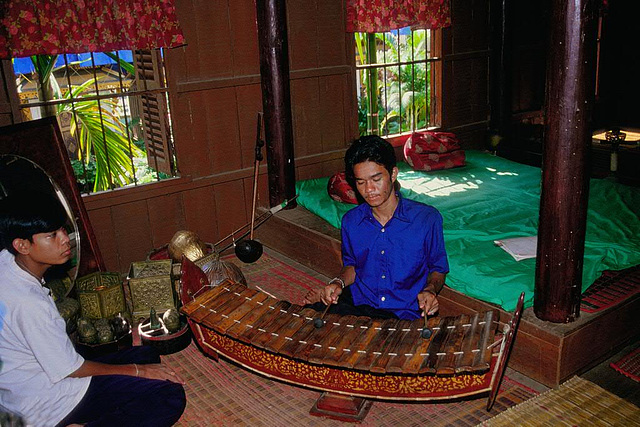 Playing the Roneat the Cambodian sticcado