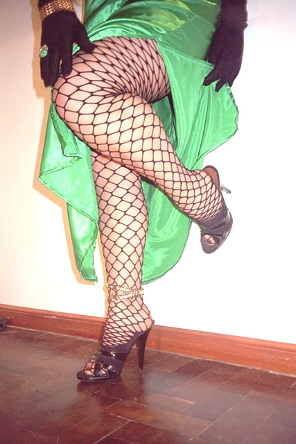 Roxy !!  Fishnet stockings and mules