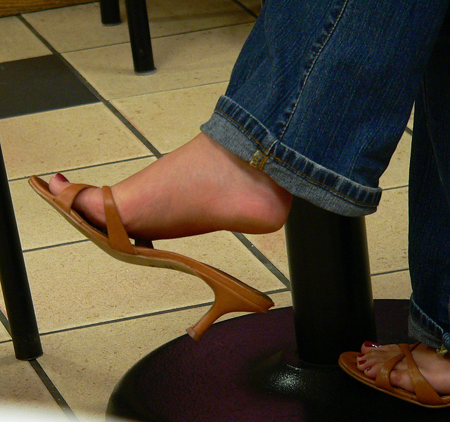 mall shot: feet and slides at coffee shop