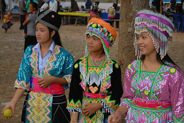 Three Hmong girls in different costumes