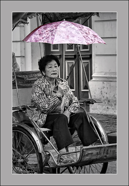 the lady with the pink umbrella