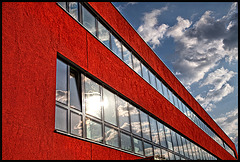 the red building and the face in the sky