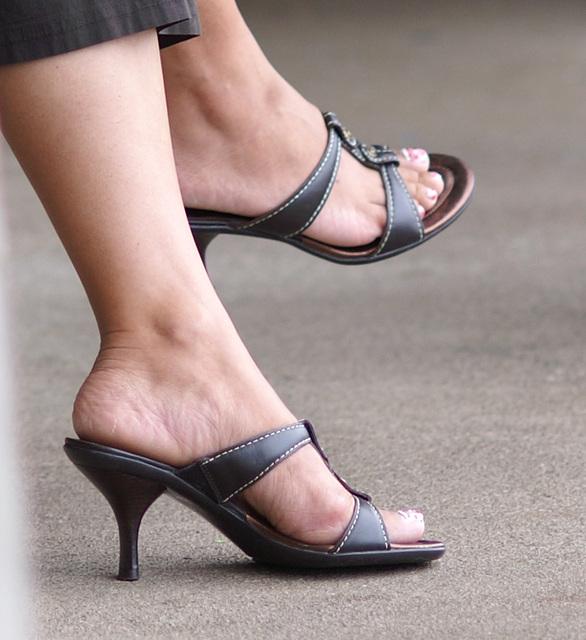 crossed legs and black heels (F)