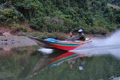 Speed boat going upstream the Nam Ou