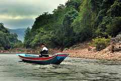 Oncoming fishing boat on Nam Ou
