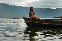 Young girl rowing her fishing boat